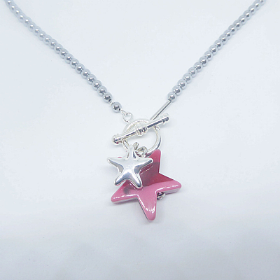 Pink resin star on hematine
