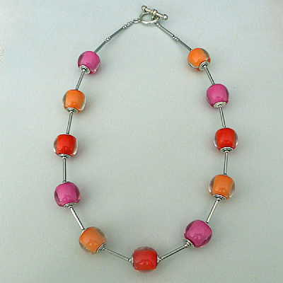 Zsiska orb necklace in pink, orange and coral
